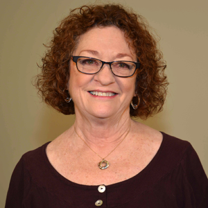 photo of a white woman in front of a beige background